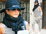 Jennifer Aniston spotted holding her bottle of smart water while out and about in New York City\n\nPictured: Jennifer Aniston\nRef: SPL1148036  091015  \nPicture by: Felipe Ramales / Splash News\n\nSplash News and Pictures\nLos Angeles: 310-821-2666\nNew York: 212-619-2666\nLondon: 870-934-2666\nphotodesk@splashnews.com\n