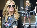 EXCLUSIVE Germany's Next Top Model host Heidi Klum looked stunning in a floral dress and leather jacket as she left her hotel in Sydney en route to a shoot.