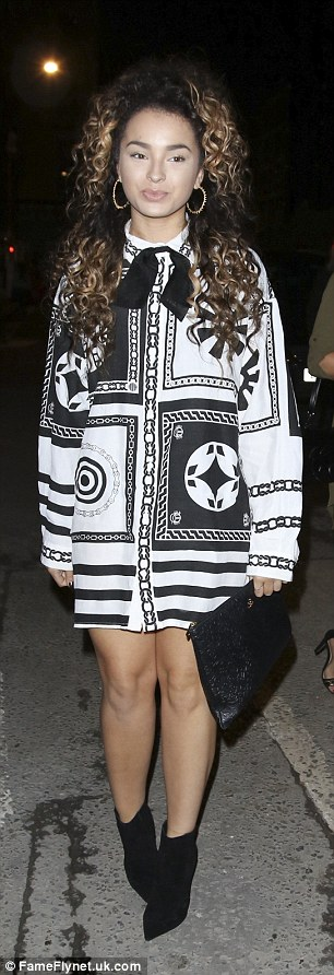 Fashionistas: Singer Ella Eyre (L) looked typically chic in a printed shirt dress and black shoe boots, while TV presenter Sarah Jane Crawford (R) kept it quirky in a white design emblazoned with an animated motif