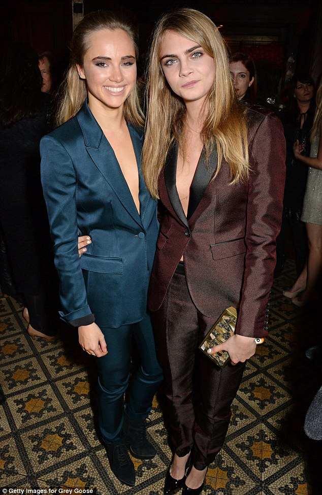 Model behaviour: Cara Delevingne and Suki Waterhouse outshone fellow attendees in their Burberry suits