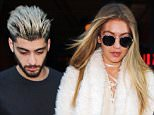 Gigi Hadid and Zayn Malik hold hands when coming out of their hotel in NYC....Pictured: Gigi Hadid, Zayn Malik..Ref: SPL1203658  060116  ..Picture by: XactpiX/Splash News....Splash News and Pictures..Los Angeles: 310-821-2666..New York: 212-619-2666..London: 870-934-2666..photodesk@splashnews.com..