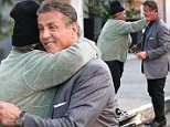 Beverly Hills, CA - Sylvester Stallone knows how to stay happy with the simpler things in life by giving some cash so a homeless woman before buying a couple pizzas togo from Mulberry Street. \n  \nAKM-GSI       January 28, 2016\nTo License These Photos, Please Contact :\nSteve Ginsburg\n(310) 505-8447\n(323) 423-9397\nsteve@akmgsi.com\nsales@akmgsi.com\nor\nMaria Buda\n(917) 242-1505\nmbuda@akmgsi.com\nginsburgspalyinc@gmail.com