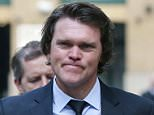 Former New Zealand cricketer Lou Vincent arrives at Southwark Crown Court, with his partner Susie Markham, where he is a witness in the trial of former New Zealand cricketer Chris Cairns, in London, Monday, Oct. 12, 2015.  Cairns faces charges of perjury and perverting the course of justice in relation to a libel case he brought against Indian Premier League founder Lalit Modi. (AP Photo/Tim Ireland)