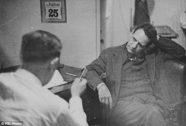 Double agent William Sebold (pictured right) talking with Nazi spy Fritz Duquesne, who was totally unaware that the FBI had installed a two-way mirror into Sebold's Times Square office
