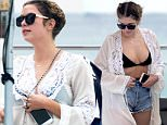 January 29, 2016: Pretty Little Liars actress Ashley Benson wears a black bikini top and jean shorts while relaxing by the pool with friends on a chilly day in Miami.\nMandatory Credit: INFphoto.com Ref: infusmi-11/13