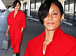 January 28, 2016: Jada Pinkett Smith sports a bright red coat as she arrives at LAX Airport. Pickett Smith is boycotting the Oscars this year for it's lack of ethnic diversity, Los Angeles, CA.\nMandatory Credit: INFphoto.com Ref.: inf-00