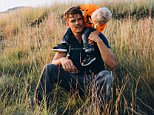 This Aug. 13, 2015 photo released by North Dakota Tourism shows actor Josh Duhamel with his toddler son Axl, in Theodore Roosevelt National Park in the Wind Canyon near Medora, N.D. Duhamel, a native of North Dakota, is serving as tourism ambassador for his home state. (North Dakota Tourism/Jesse Nelson via AP)