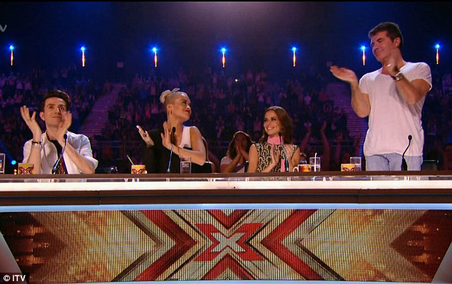 The panel: And it was down to Simon, Cheryl, Rita and Nick to put him through the Boot Camp stage