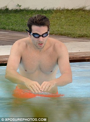 Quick dip! Bradley was seen sporting a pair of goggles as he enjoyed a dip in the hotel swimming pool