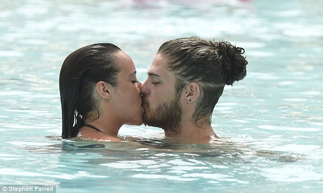 Sizzling display: The soap star looked to be thoroughly enjoying herself as she kissed her man