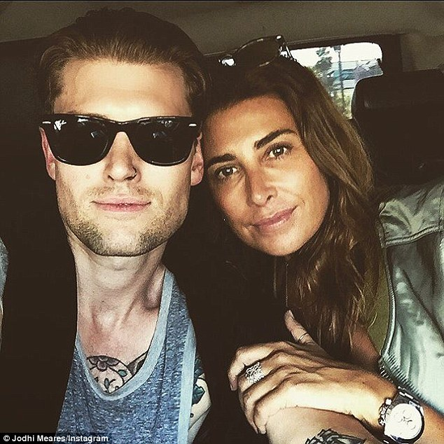 More than friends? Jodhi Meares again cosies up to her mystery man - revealed to be Australian-born photographer Nick Finn - in a shot posted to Instagram on Sunday after a weekend together in LA