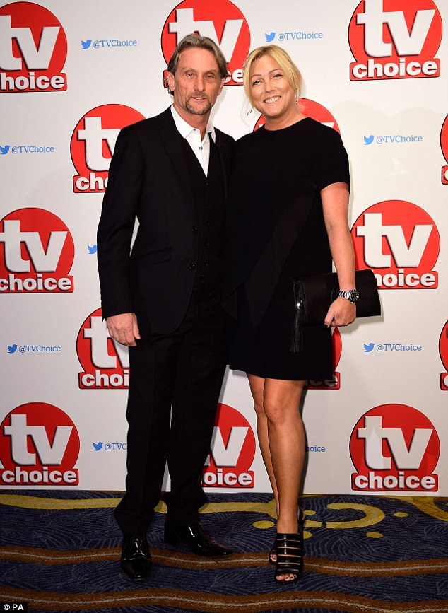Night out: Carl and Michaela Fogarty looked picture perfect together