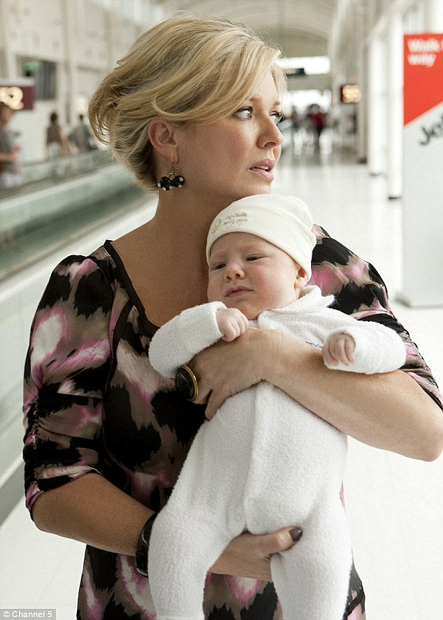 In character: Emily plays Marilyn on Home And Away, seen here cradling another character's baby in 2011