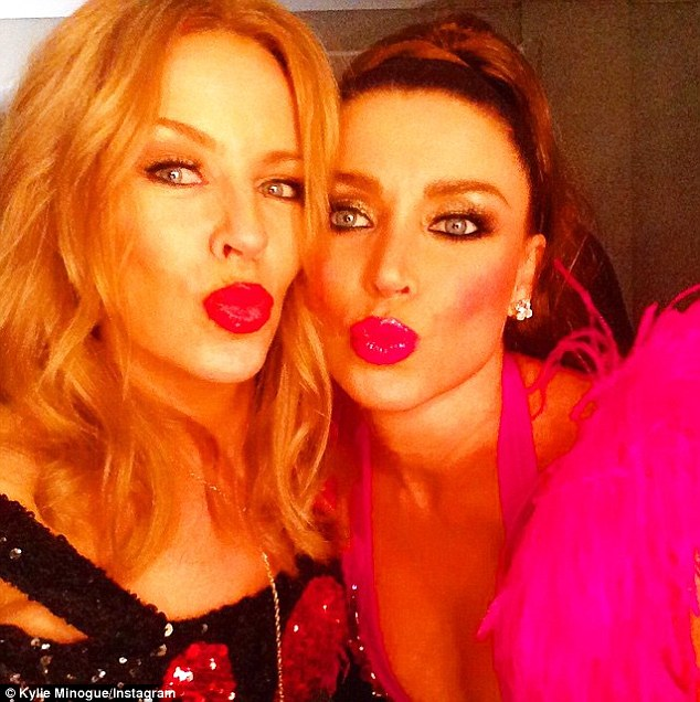 Kylie shared this image with her younger sister ahead of Danni's performance at Sydney Mardi Gras