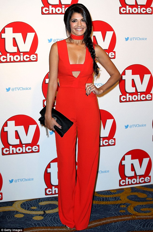 Sizzling: Natalie Anderson dressed her lean and slender frame in a bold red jumpsuit