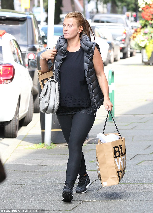 Casual chic: Coleen Rooney dressed down in all-black as the headed to the shops in Cheshire on Monday