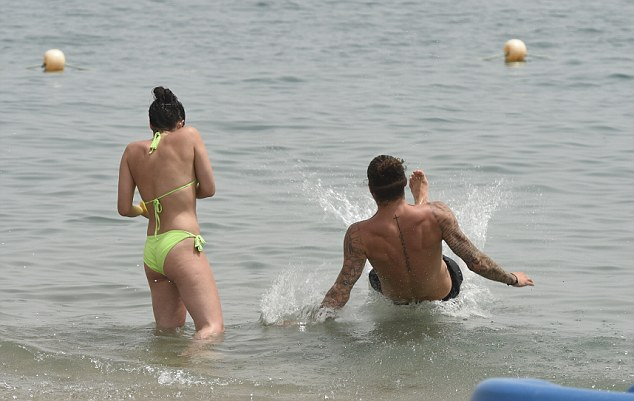 Making a splash: Sam splashed his girlfriend as he landed in the sea with a crash