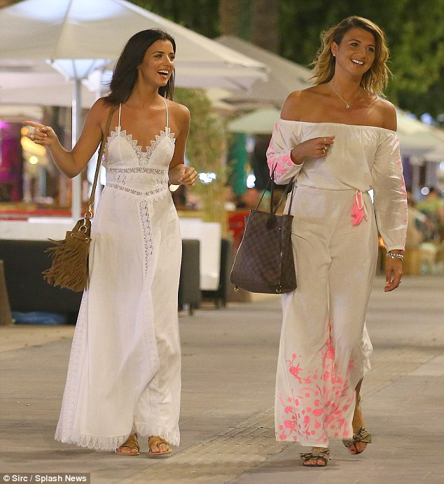 Happy pair: Lucy Mecklenburgh, 24, was seen enjoying a holiday with her older sister Christie in Ibiza, as the two made their way out for the evening in similar white ensembles