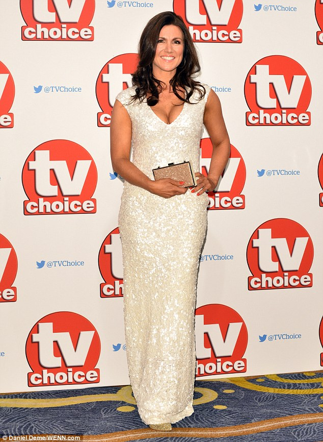 Golden glow: The 44-year-old Good Morning Britain presenter looked absolutely stunning in a figure-hugging white, sequinned gown, which displayed her tanned décolletage to perfection