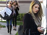 Friday, January 29, 2016 - Louis Tomlinson's baby mama Brianna Jungwirth takes baby Freddie to her mother's apartment outside Los Angeles.  The new mom is overwhelmed by the attention and paparazzi and hides her face.  She's carrying little Freddie's pacifier in her right hand with her phone. ROL/X17online.com