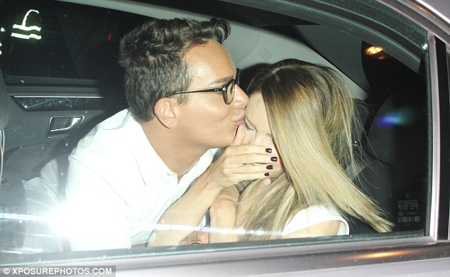 Giz a kiss: Katie Piper's date for the evening - make-up artist Toby Salvietto - planted a friendly kiss on her face in the back of a taxi following the TV Choice Awards 2015 on Monday evening
