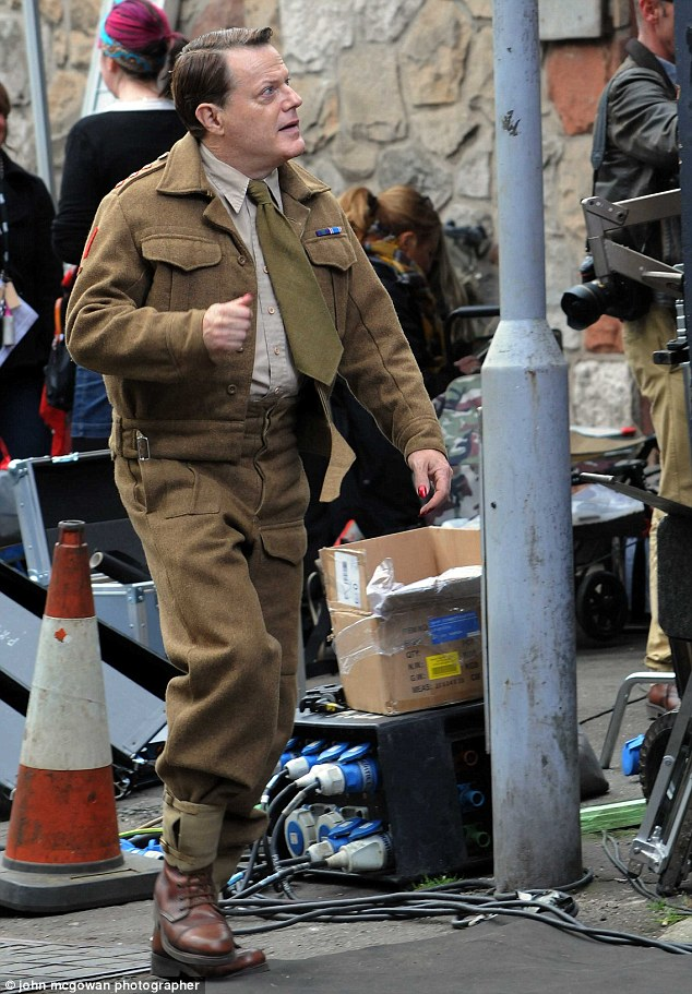 Leading man: Sporting a commander's wartime uniform, the 53-year-old - who plays central lead Captain Wagget – looked very much in character