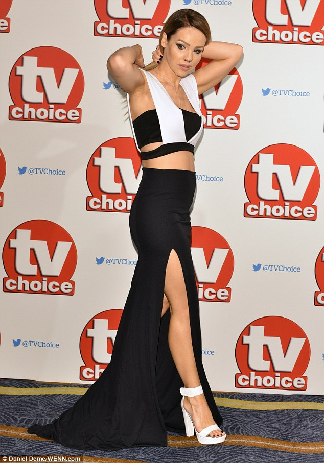 The thigh's the limit: Katie flashed almost the full length of her slender legs in a black thigh-split maxi skirt as she attended the TV Choice Awards