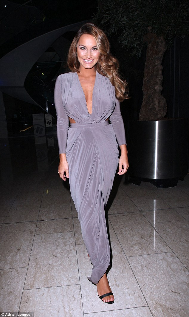 Dressed to impress: The reality star complimented the look with a metallic make-up look that consisted of a smokey silver eye-shadow, shimmering cheeks and a nude lipstick