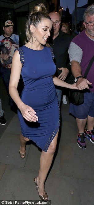 Eye-catching:The singer displayed her slender frame in a fitted blue dress while making her way past onlookers before being ushered into the rear of a waiting car