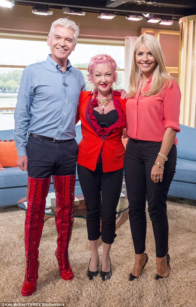Star guest: Phillip admitted it was difficult trying to hide his boots during his interview with Cyndi, who has written the music for the Kinky Boots musical which is hitting the West End this month