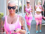 """Picture Shows: Amber Rose  January 29, 2016    Model Amber Rose shows off her curvy figure while enjoying a post-workout drink from Starbucks in Studio City, California. Amber was recently involved in a war of words on Twitter with her ex-boyfriend Kanye West. Amber, known for her outspoken ways, was rocking a tank top that read: """"Do No Harm, But Take No Shit.""""     Exclusive All Rounder  UK RIGHTS ONLY    Pictures by : FameFlynet UK © 2016  Tel : +44 (0)20 3551 5049  Email : info@fameflynet.uk.com"""