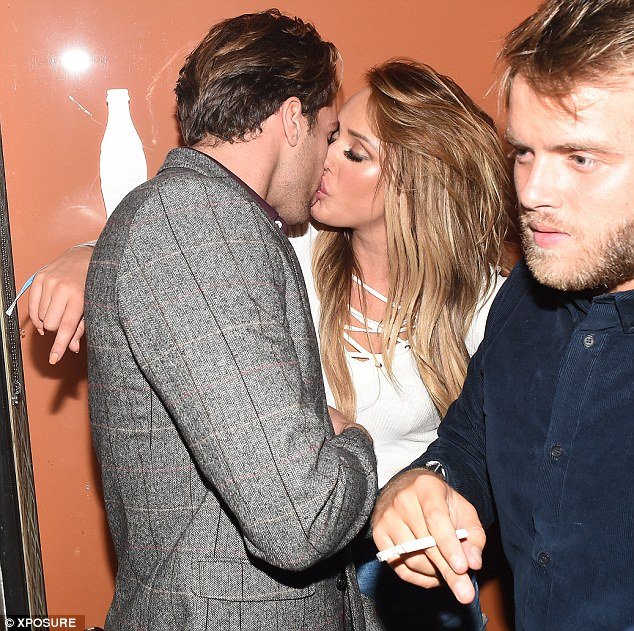 Heavy pet-ting: Charlotte and Max were caught on camera passionately kissing following the Jeans For Genes event in London last week