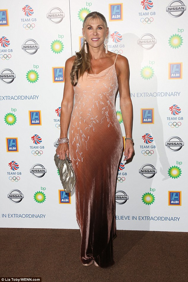 Toned: Retired swimmer Sharon Davies showcased her toned arms in a peach, velvet gown