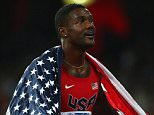 Athlete Justin Gatlin of the United States celebrates after crossing the finish line to win silver in the Men's 200 metres final during day six of the 15th IAAF World Athletics Championships Beijing 2015 at Beijing National Stadium on August 27, 2015 in Beijing, China.     BEIJING, CHINA - AUGUST 27:   (Photo by Ian Walton/Getty Images)
