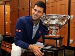 MELBOURNE, AUSTRALIA - FEBRUARY 01:  Novak Djokovic of Serbia poses with the Norman Brookes Challenge Cup in the players change rooms after winning the Men's Singles Final against Andy Murray of Great Britain during day 14 of the 2016 Australian Open at Melbourne Park on February 1, 2016 in Melbourne, Australia.  (Photo by Cameron Spencer/Getty Images)