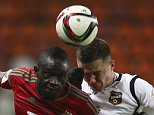 MOSCOW, RUSSIA - DECEMBER 04: Baye Oumar Niasse (L) of FC Lokomotiv Moscow challenged by Aleksandr Sapeta of FC Ural Sverdlovsk Oblast during the Russian Premier League match between FC Lokomotiv Moscow and FC Ural Sverdlovsk Oblast at Lokomotiv Stadium on December 04, 2015 in Moscow, Russia. (Photo by Epsilon/Getty Images)