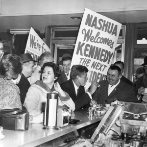 Senator Kennedy stops to eat in a diner in Nashua, New Hampshire. (Photograph in the John F. Kennedy Library, Boston.)
