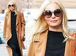 EXCLUSIVE: Kate Bosworth spotted wearing Cat Eye Sunglasses and camel coat while out and about in New York City, after she takes a trip to Barney's New York on Madison Avenue\n\nPictured: Kate Bosworth\nRef: SPL1217862  290116   EXCLUSIVE\nPicture by: Felipe Ramales / Splash News\n\nSplash News and Pictures\nLos Angeles: 310-821-2666\nNew York: 212-619-2666\nLondon: 870-934-2666\nphotodesk@splashnews.com\n