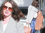 Picture Shows: Anne Hathaway  January 29, 2016\n \n Pregnant Anne Hathaway meets with a trainer at a gym in West Hollywood, California. Anne looked stylish, wearing aviators and carrying what looked to be a large, brown fur coat.\n \n Non-Exclusive\n UK RIGHTS ONLY\n \n Pictures by : FameFlynet UK © 2016\n Tel : +44 (0)20 3551 5049\n Email : info@fameflynet.uk.com