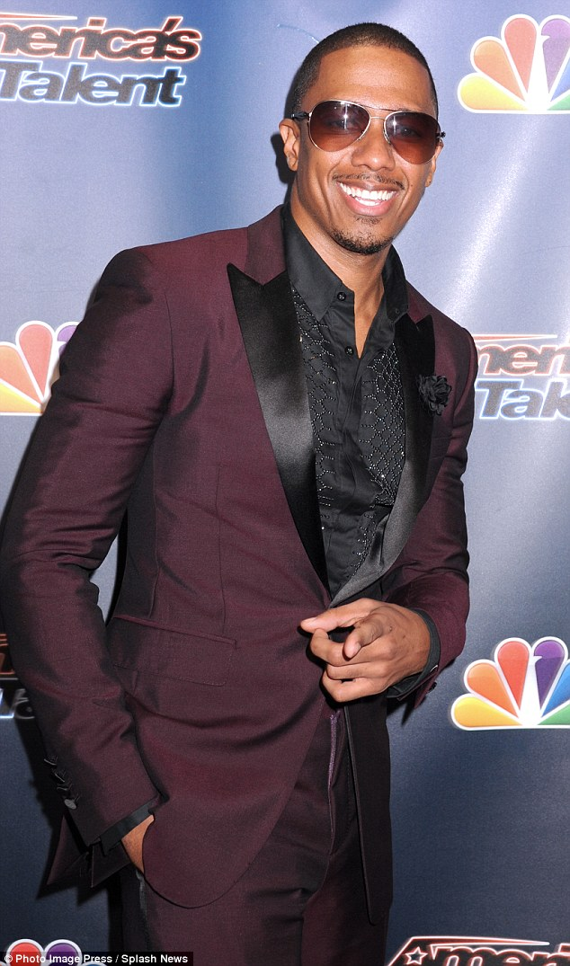 Host with the most: Nick Cannon hid his eyes behind a pair of sunglasses as he posed ahead of the show