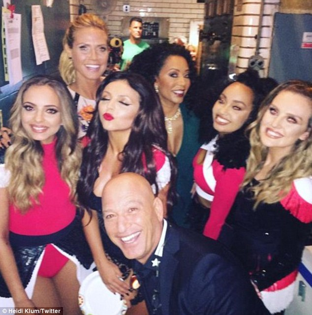 Good times: The girls joined the AGT judges Heidi Klum, Mel B andHowie Mandel for a picture