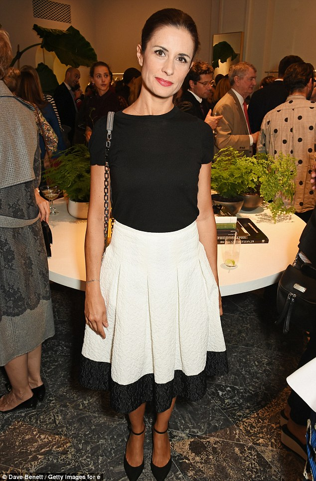 Super chic: Livia Firth meanwhile was smart in a monochrome skirt and strappy shoes