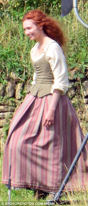 In character: 23-year-old Eleanor - who plays Poldrak's beautiful wife Demelza - was dressed in a 18th century farm girl's dress, while her luscious red locks were left in loose wave
