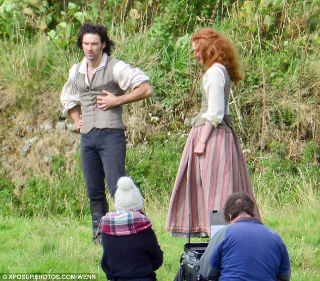 Back to it: The two stars appeared to be in relaxed and content spirits as shot new scenes on Cornish pastures