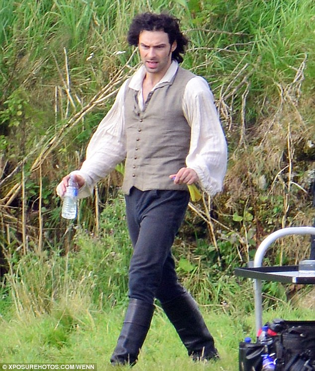 Leading man: Slipping back firmly into character for filming, the Irish heartthrob was clad in the typical period attire