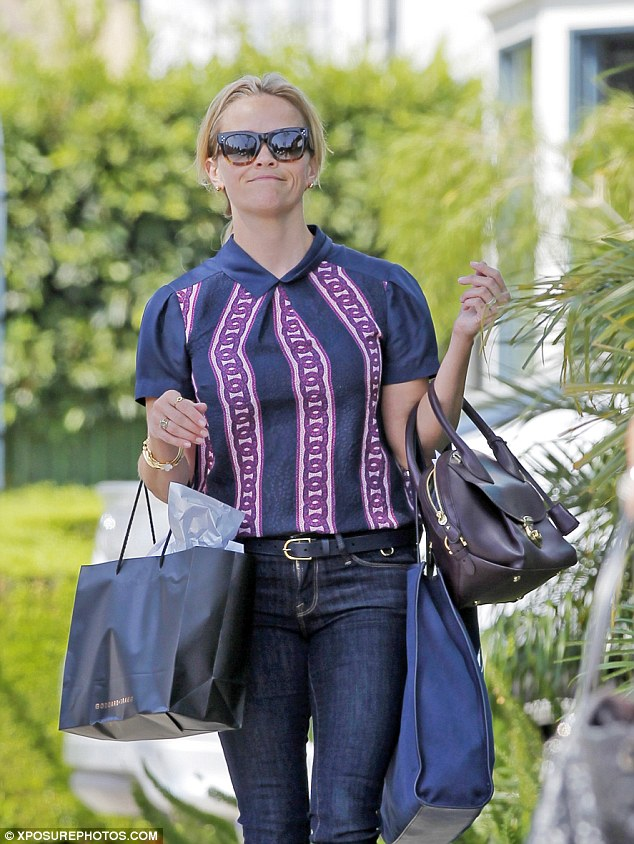 Laiden down: She also carried a number of other bags with her