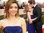 LOS ANGELES, CA - JANUARY 30:  Actors Sarah Hyland (L) and Dominic Sherwood kiss on the red carpet at The 22nd Annual Screen Actors Guild Awards at The Shrine Auditorium on January 30, 2016 in Los Angeles, California. 25650_016  (Photo by Stefanie Keenan/Getty Images for Turner)