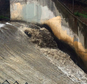 Runoff gushes down a spillway in the Arroyo Seco, which translates to 'dry creek' or 'dry stream' in Spanish, in Pasadena, Calif., as rain drenches the region Sunday, Jan. 31, 2016. Southern California was drenched Sunday as the latest winter storm brought downpours, heavy winds and mountain snow. A flash flood watch was issued for foothill neighborhoods underneath wildfire burn areas, triggering fears of possible mudslides and debris flows.(AP Photo/John Antczak)