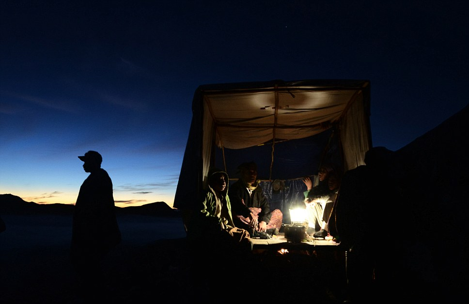 Religious significance: Local shaman give the prayer at the earth before it is dedicated to the crater of Mount Bromo