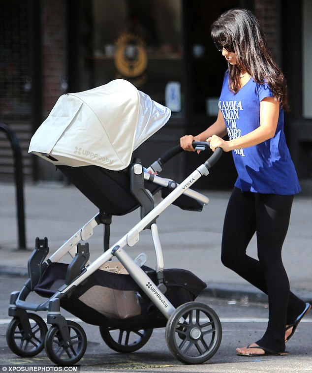 Pushy parent: Hilaria Baldwin was spotted taking her baby son Alex for a walk in New York on Wednesday